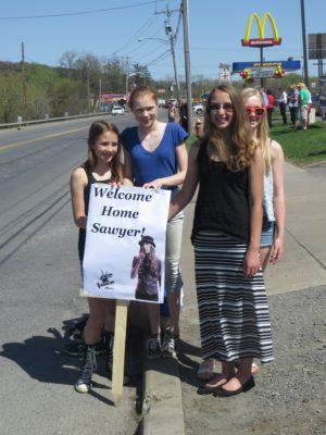 Girls Holding Sawyer Fredericks Sign