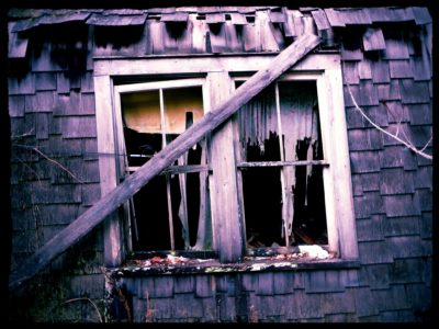 Tattered-Curtains-In-The-Window